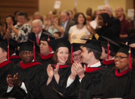 Theology students applaud at graduation